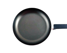 Top Angle Red Non-Stick Frypan by Idaman Suri