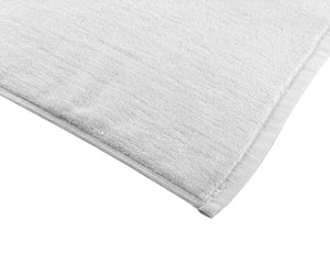 Opened white cotton bath mat by Idaman Suri