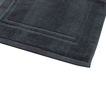 Opened grey cotton bath mat by Idaman Suri