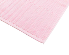 Opened pink cotton bath mat by Idaman Suri
