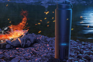Cauldryn Fyre Mobile heated thermos near a campfire and creek at night