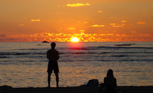 canoe paddlers at sunset in Waikiki