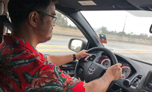 dad driving a minivan in a Magnum PI Aloha shirt