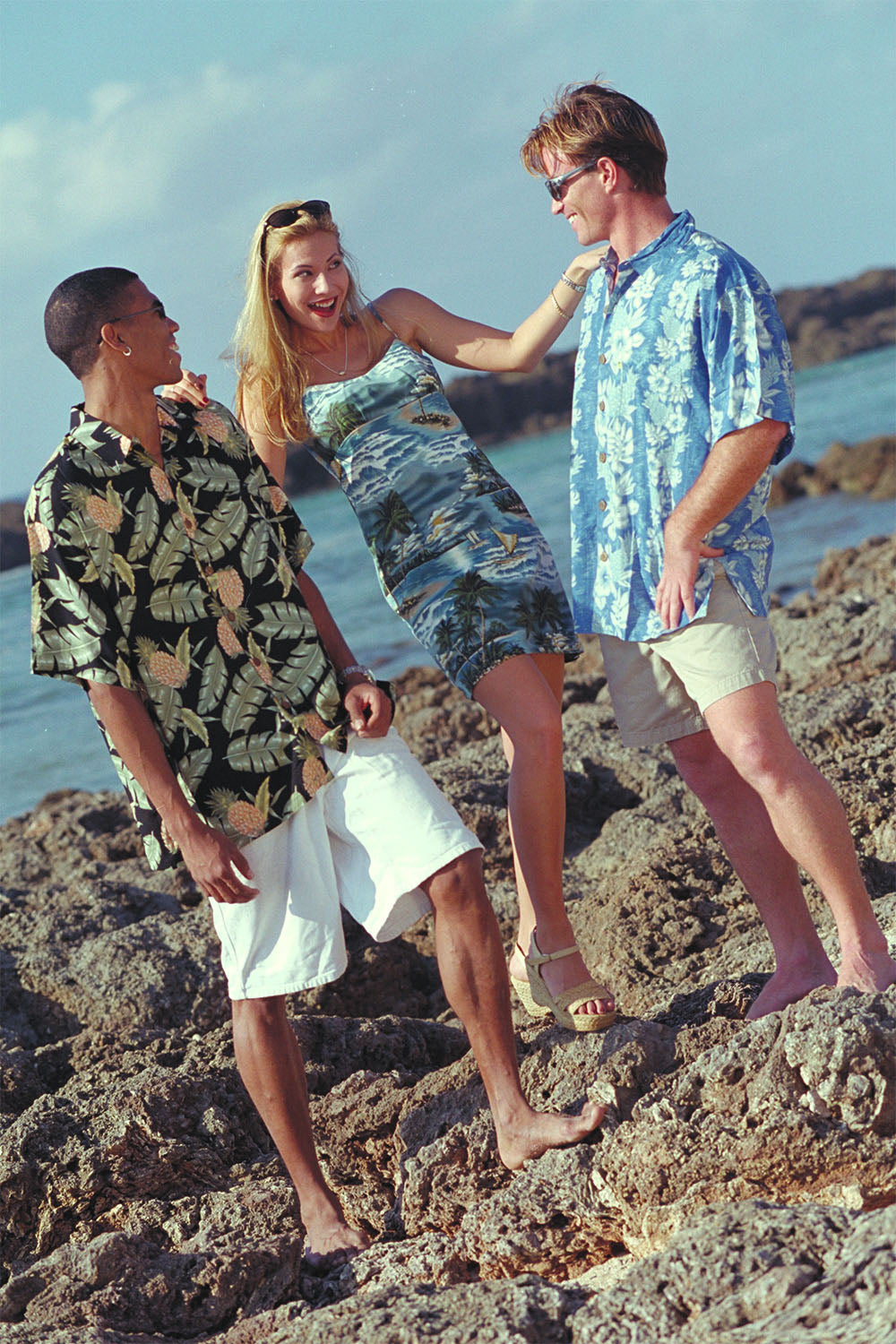 Angel having fun with Casey and Jason in a spaghetti hawaiian dress
