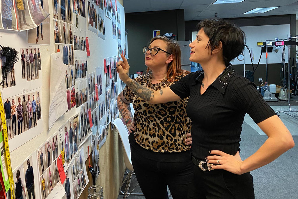 Ashely Heathcock and Alison Uhlfelder looking at the episode costume board for Magnum PI