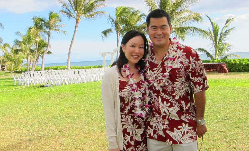 beach wedding guests wearing matching floral dress and Hawaiian shirt