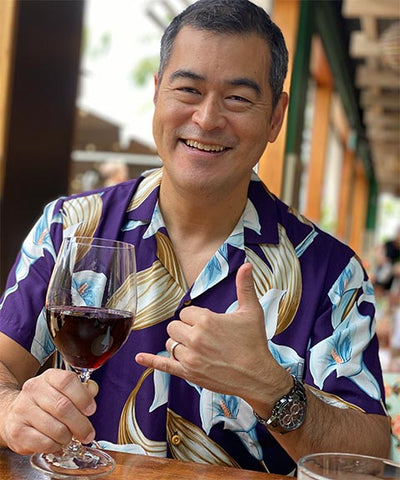 Calla Lily purple Hawaiian shirt (Magnum PI shirt) and a glass of red wine