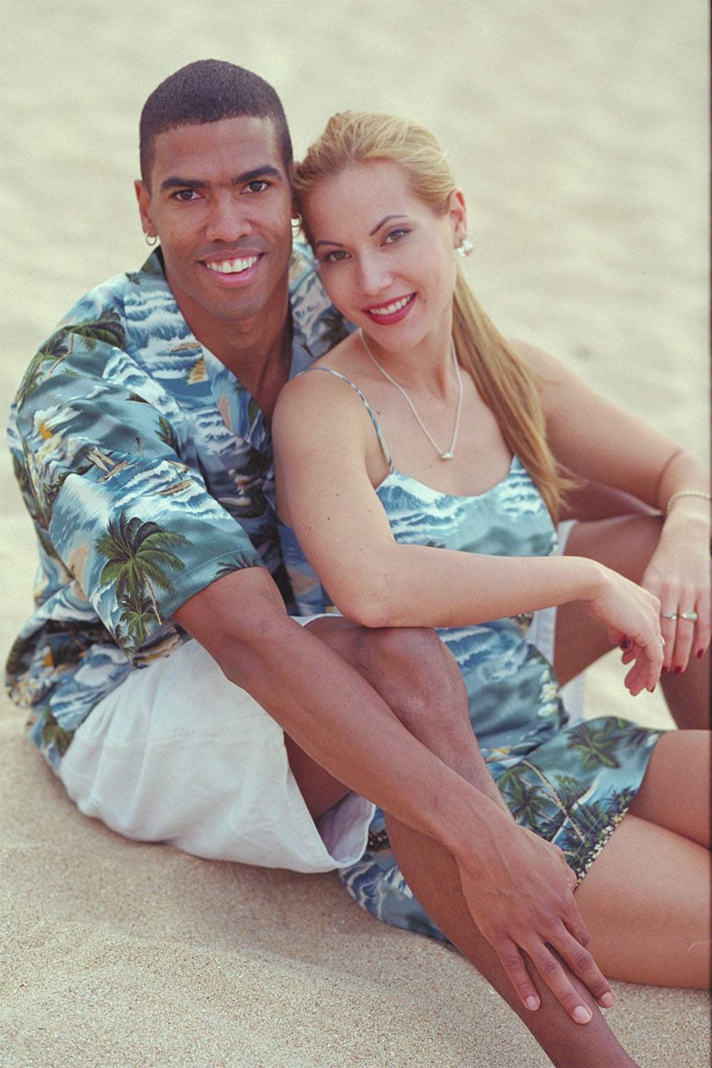 Casey and Angel in matching Hawaiian shirt and dress