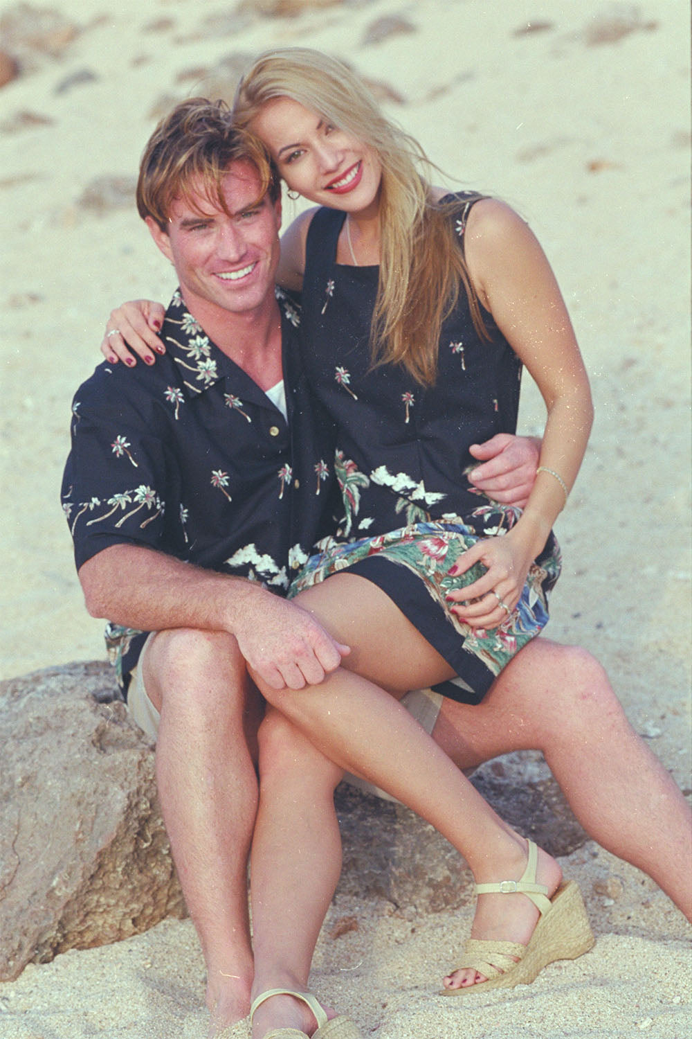 Jason and Angel in matching black Hawaiian shirt and dress