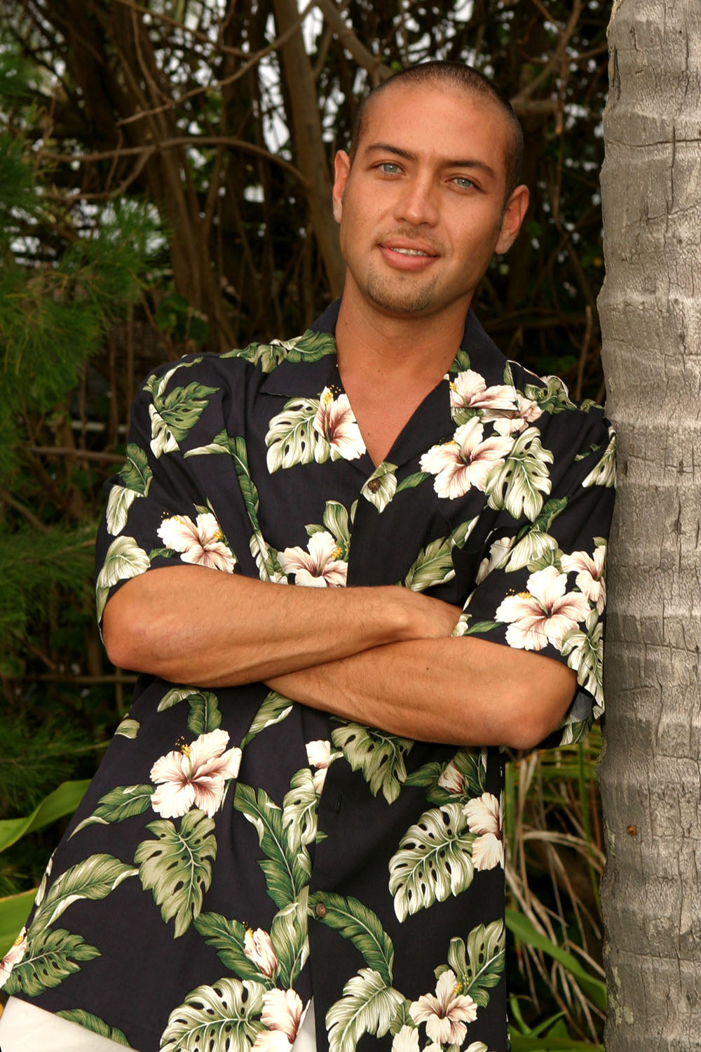 Jonah in a black rayon Aloha shirt