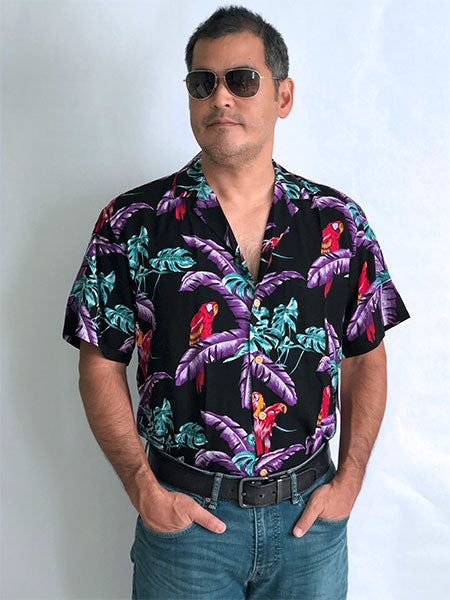 Magnum PI shirt (black) tucked into blue jeans with belt