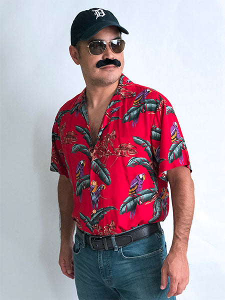 1980s Magnum PI outfit with red Hawaiian shirt, baseball cap, and mustache
