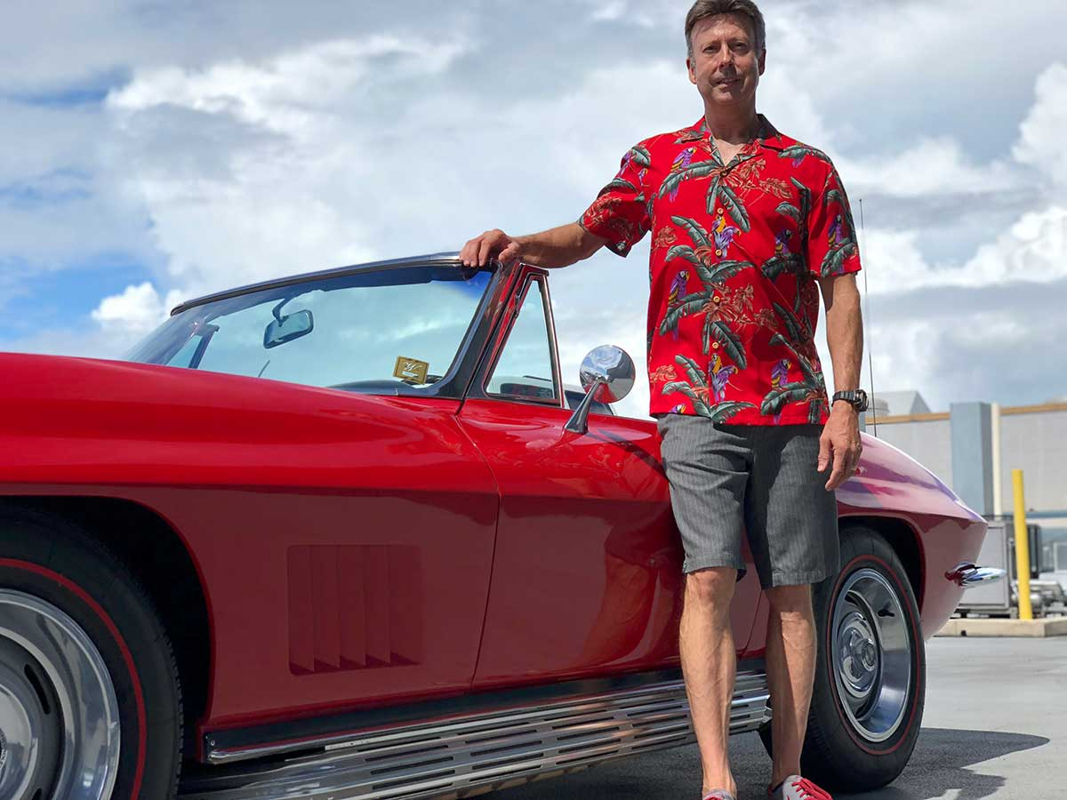 Magnum PI shirt and a red 1967 Corvette Stingray