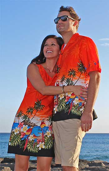 couple in matching parrot Hawaiian shirt and dress