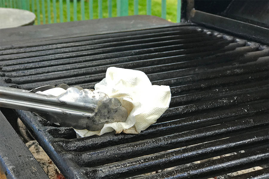 wipe the grill using an oil soaked paper towel to prevent food from sticking