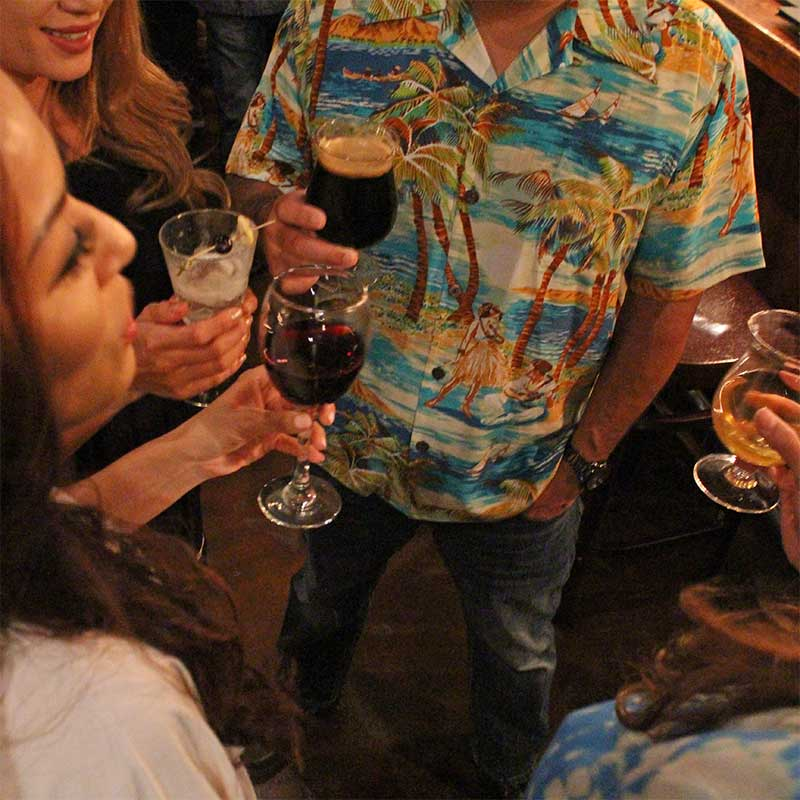 happy hour in a retro Hawaiian shirt and blue jeans
