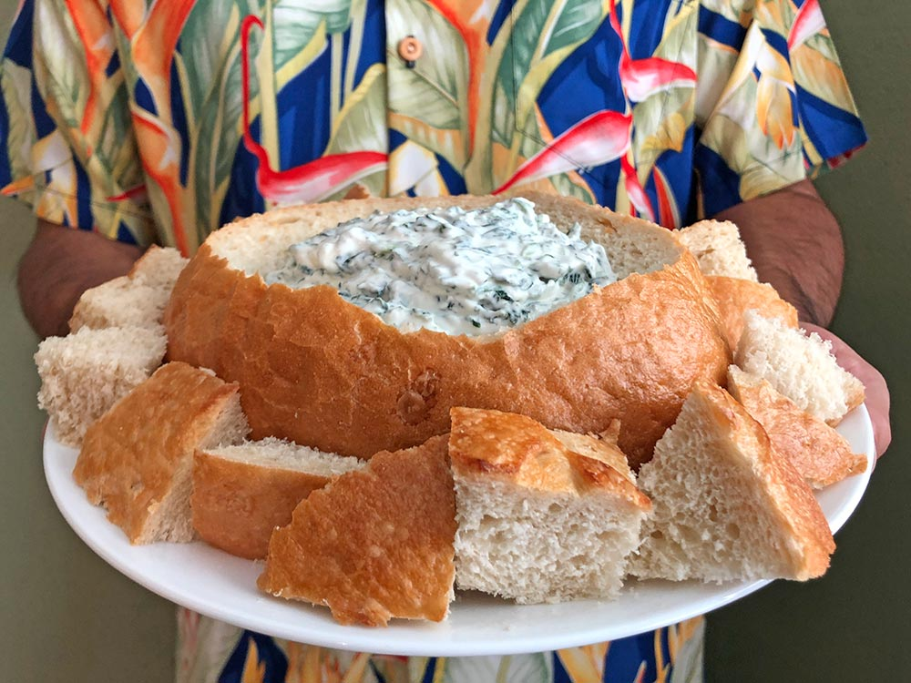 spinach dip in a sourdough bread bowl