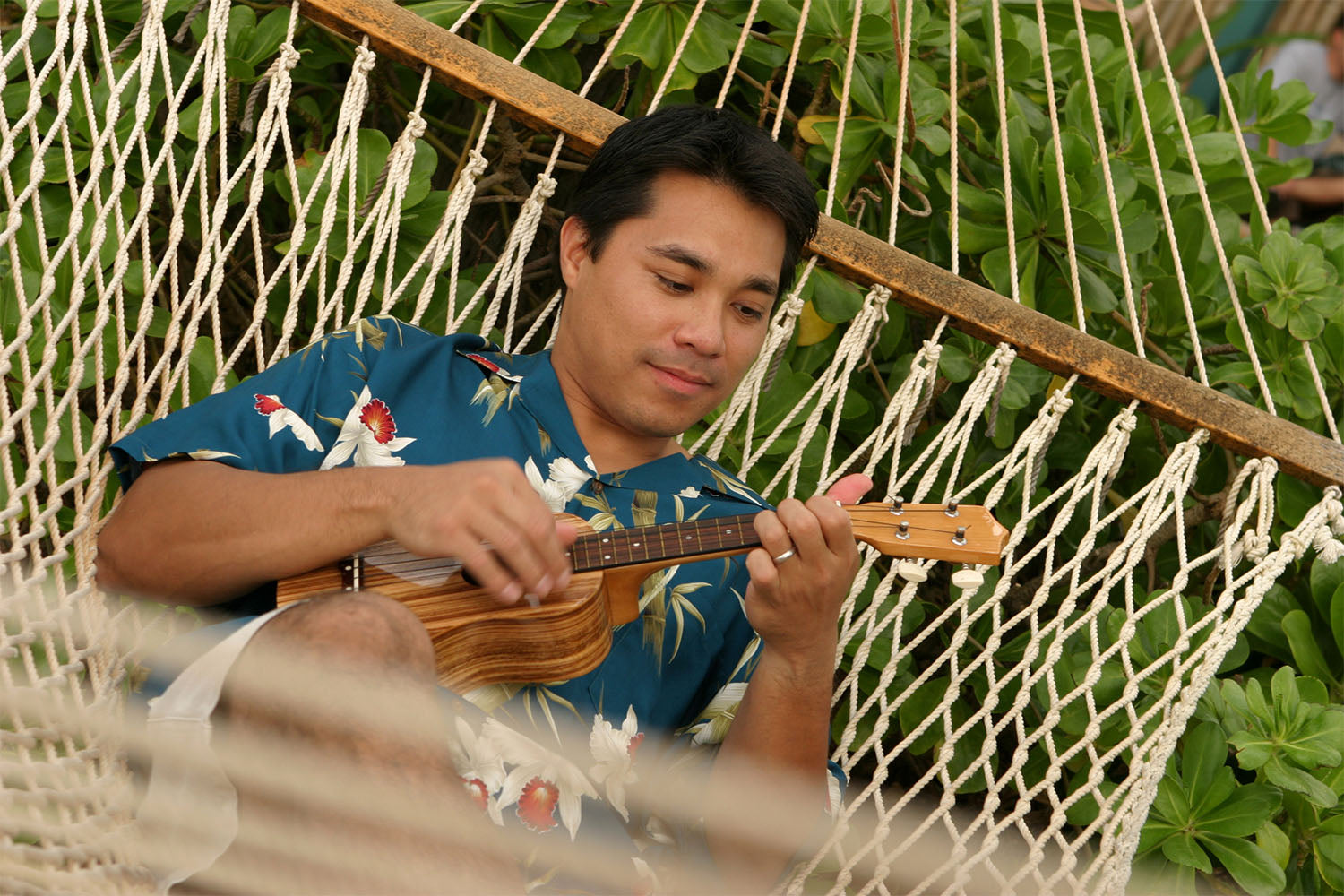 relaxing in an Aloha shirt with an ukulele