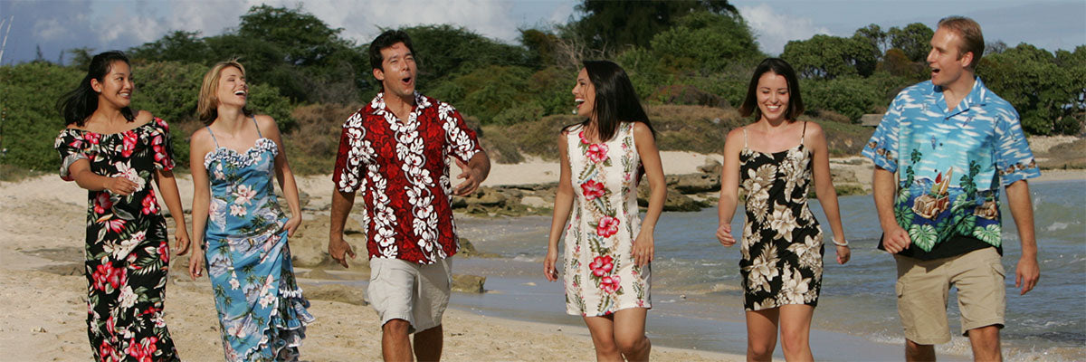 strolling on the beach in Hawaiian shirts and dresses