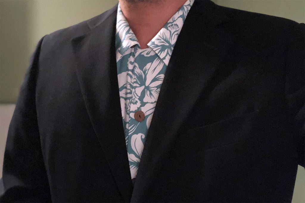 wearing a Hawaiian shirt with a suit