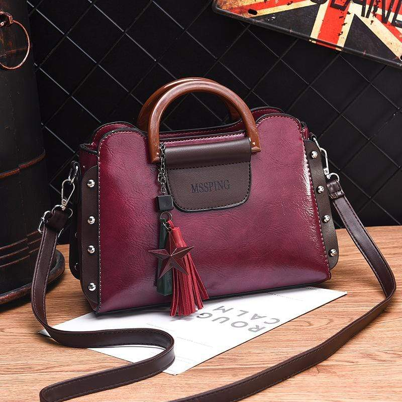 Obangbag Wine Red Women Retro Stylish Tassel Leather Handbag Crossbody Bag