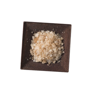 Geometric Pyramidal Walnut salt dish with Maldon sea salt flakes. Salt tray