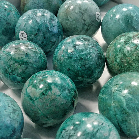 ic:Crystal spheres can help reduce feelings of anxiety and increase joy by triggering a sense of playfulness