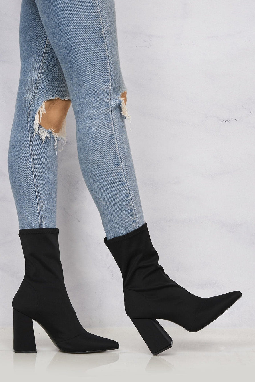 Everly Pointed Toe Flare Heel Calf Boot in Black Lycra