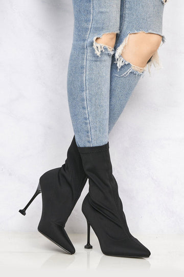 Adele Pointed Toe Flat Heel Tip Boot in Black Lycra