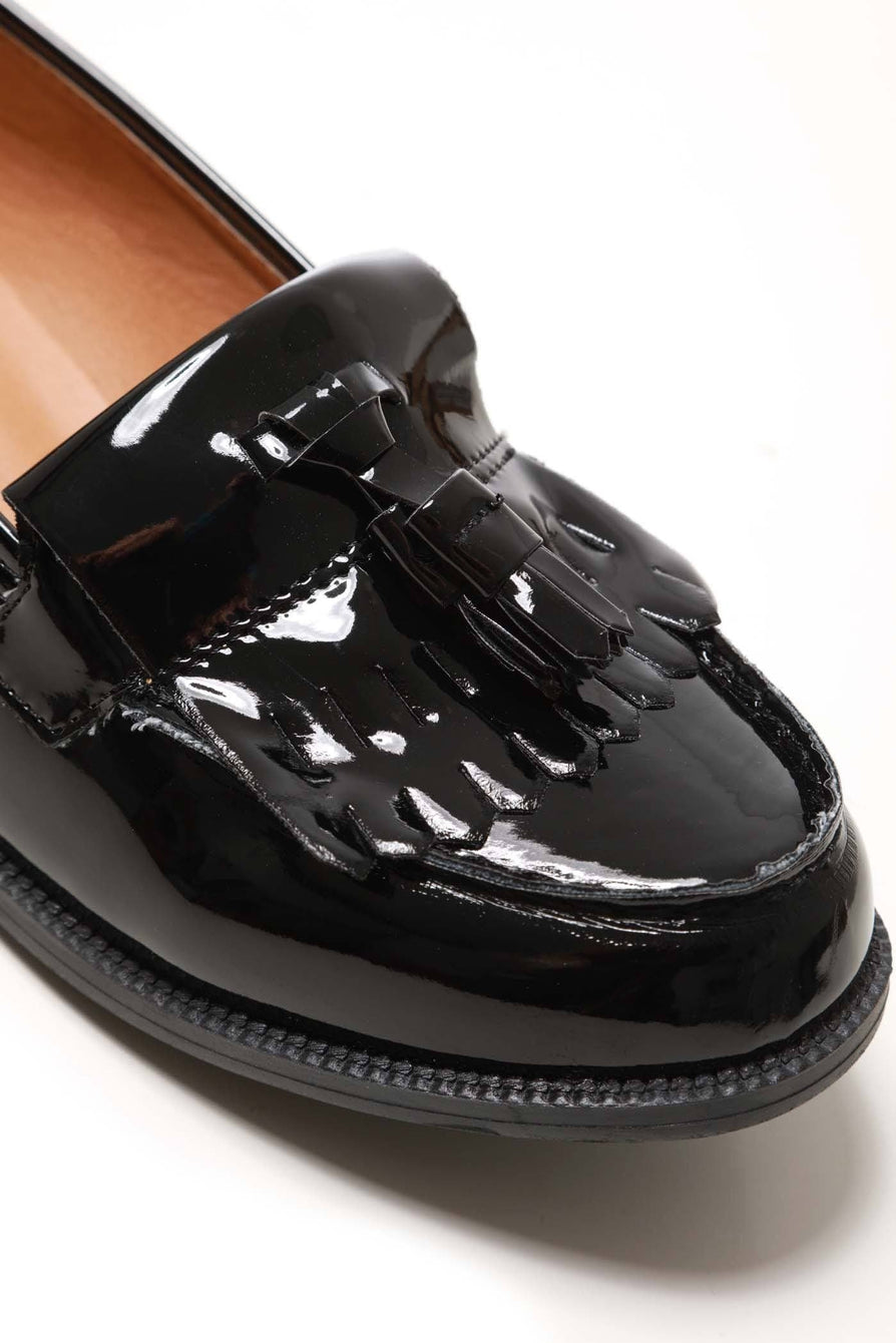 Evie Flat Fringe Toggle Loafer in Black Patent