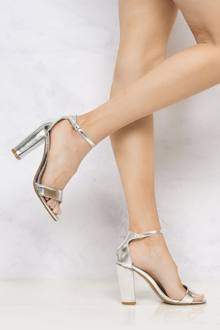 May Barely There Block Heel Ankle Strap Sandal In Silver