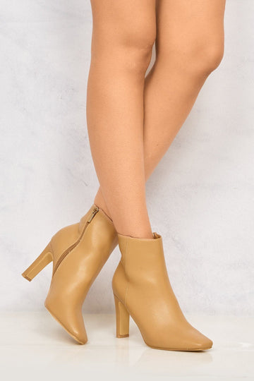 Merlin Pointed Toe Flare Heel Ankle Boot in Beige
