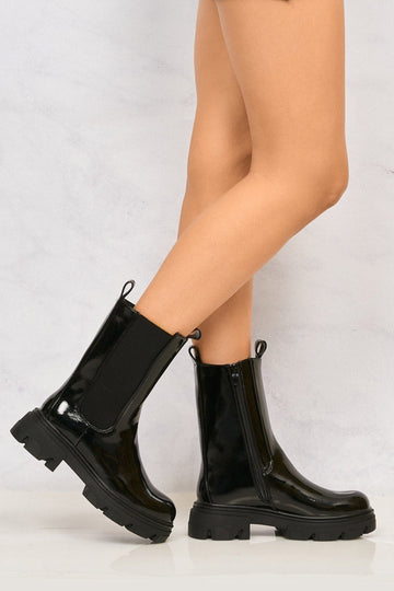 Merry Elastic Panel Slip On Calf Boot in Black Patent