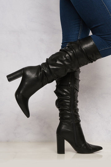 Bonnie Rouched Pointed Toe Knee High Boot in Black