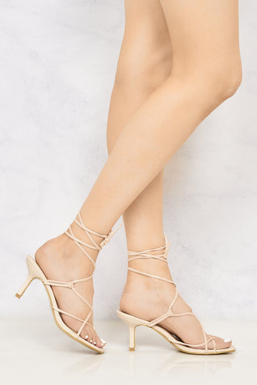 Melissa Mid Heel Lace Up Strap Cross Front Open Toe Sandal In Nude