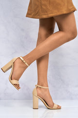 May Barely There Block Heel Ankle Strap Sandal In Nude Patent