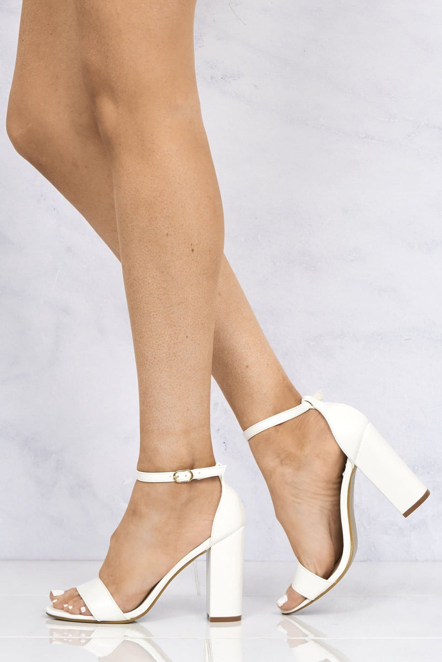May Barely There Block Heel Ankle Strap Sandal In White Matt