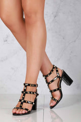 Abigail ankle strap with studs sandal in Black Patent