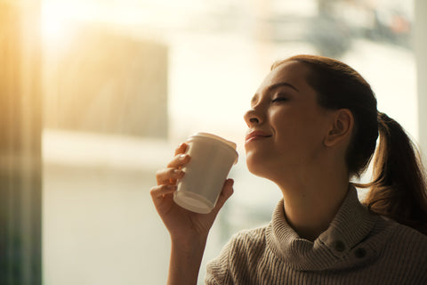 Woman enjoying cup of coffee in the morning