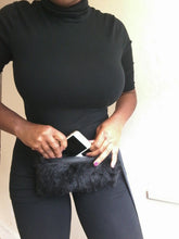 Black faux fur belt bag holds your small essentials