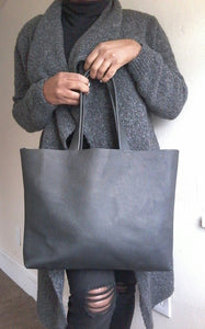 Black leather tote back