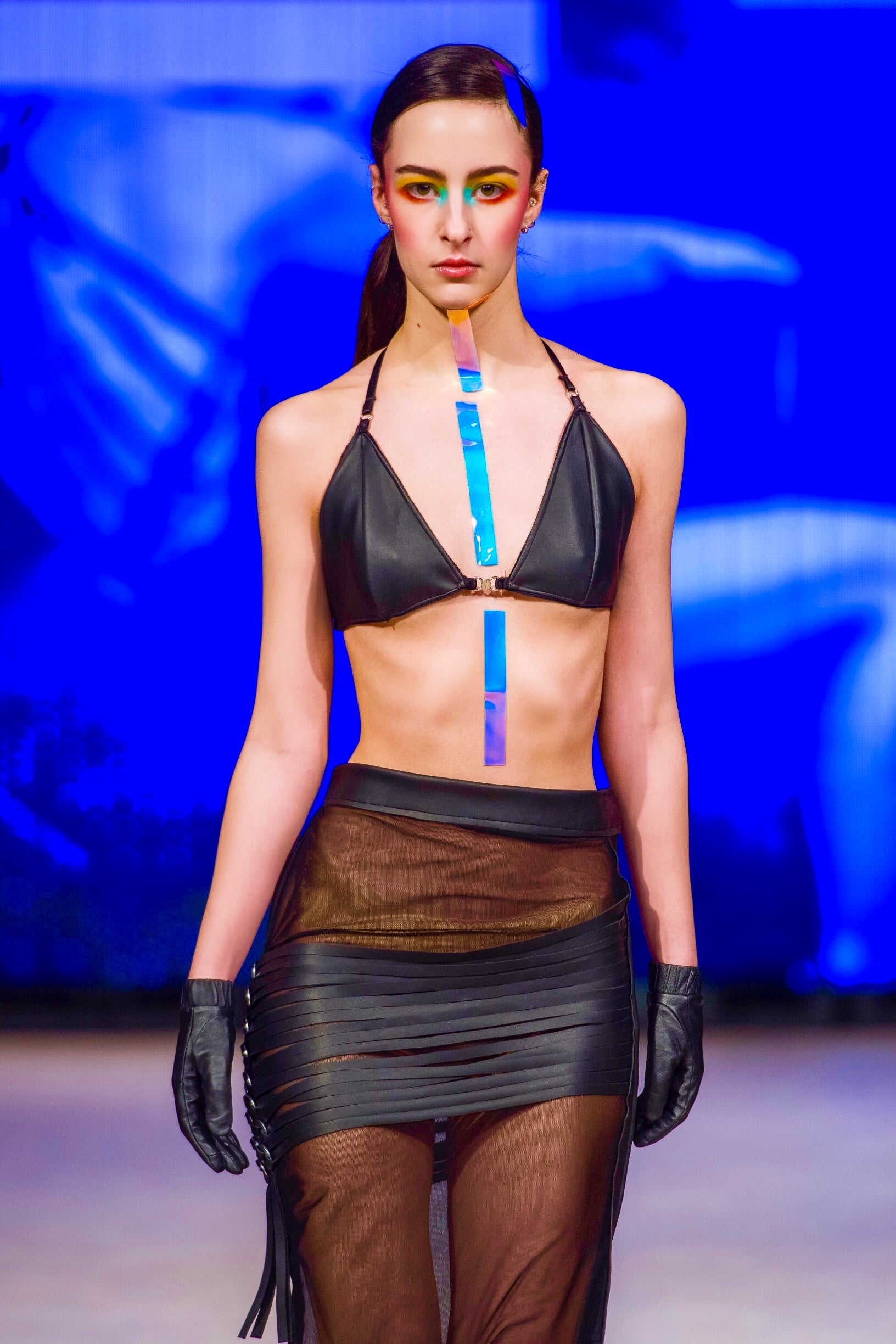 Sheer stretch tulle skirt with diagonal woven straps detail and black leather bra top (sold separately)