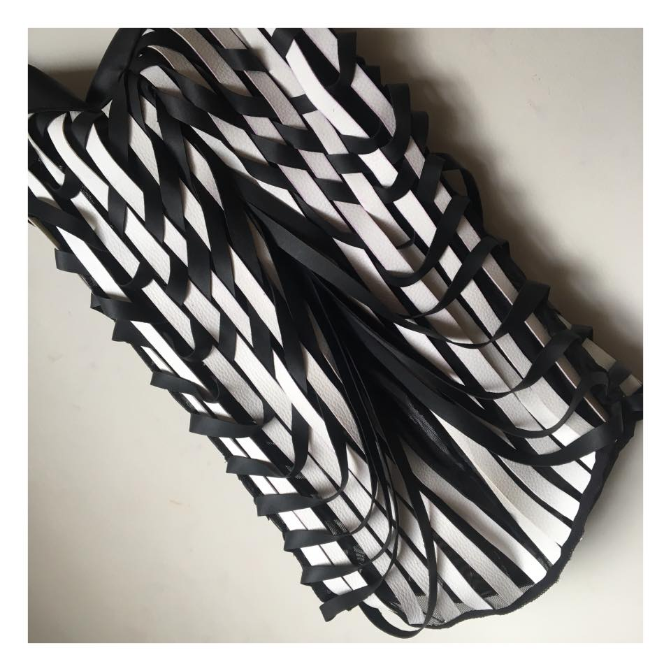Black and white op art vegan leather hand weaved straps balloon skirt .