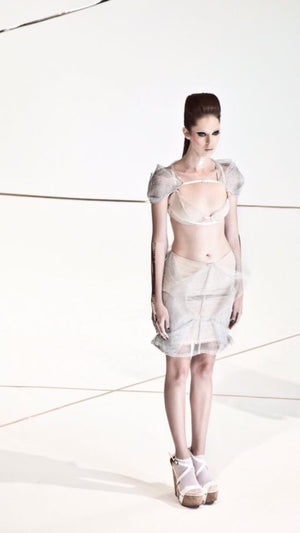Silver origami folded into square shape tulle skirt over nude tone base.
