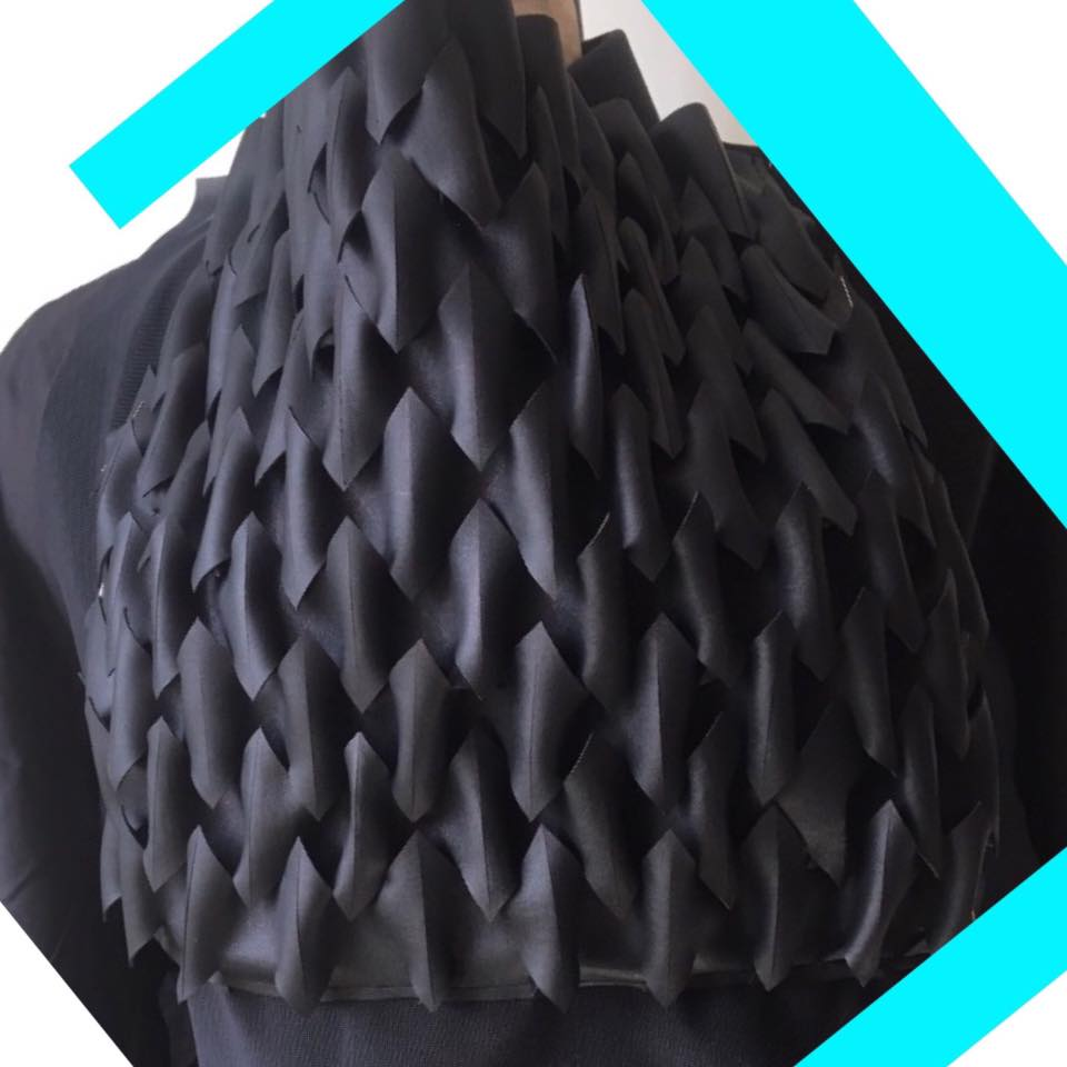 Backless top with vegan  black  leather  origami 3D   hand worked cubes front.