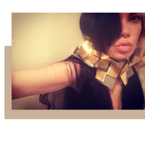 Vegan gold leather origami cubes assembled neckpiece shown with various tops and skirts  or on its own