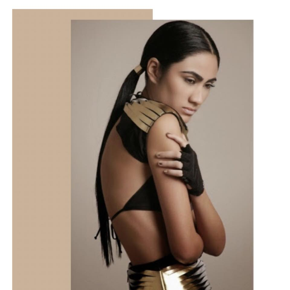 Black  elastic power net shoulder pads accessory with gold vegan leather twisted straps detail .