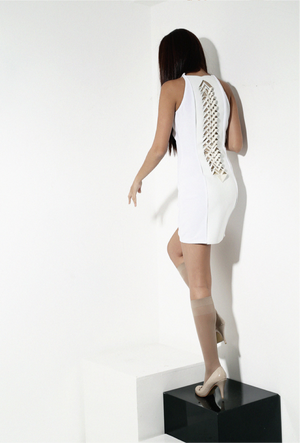 White dress with white vegan leather spinal cord origami folded detail in back.