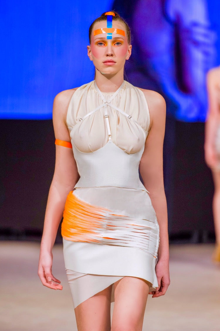 White leather and neon orange tulle skirt with harness(sold separately) and beige halter top (sold separately)
