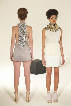 Backless crepe halter tops in nude, off white and or black shown with various skirts.